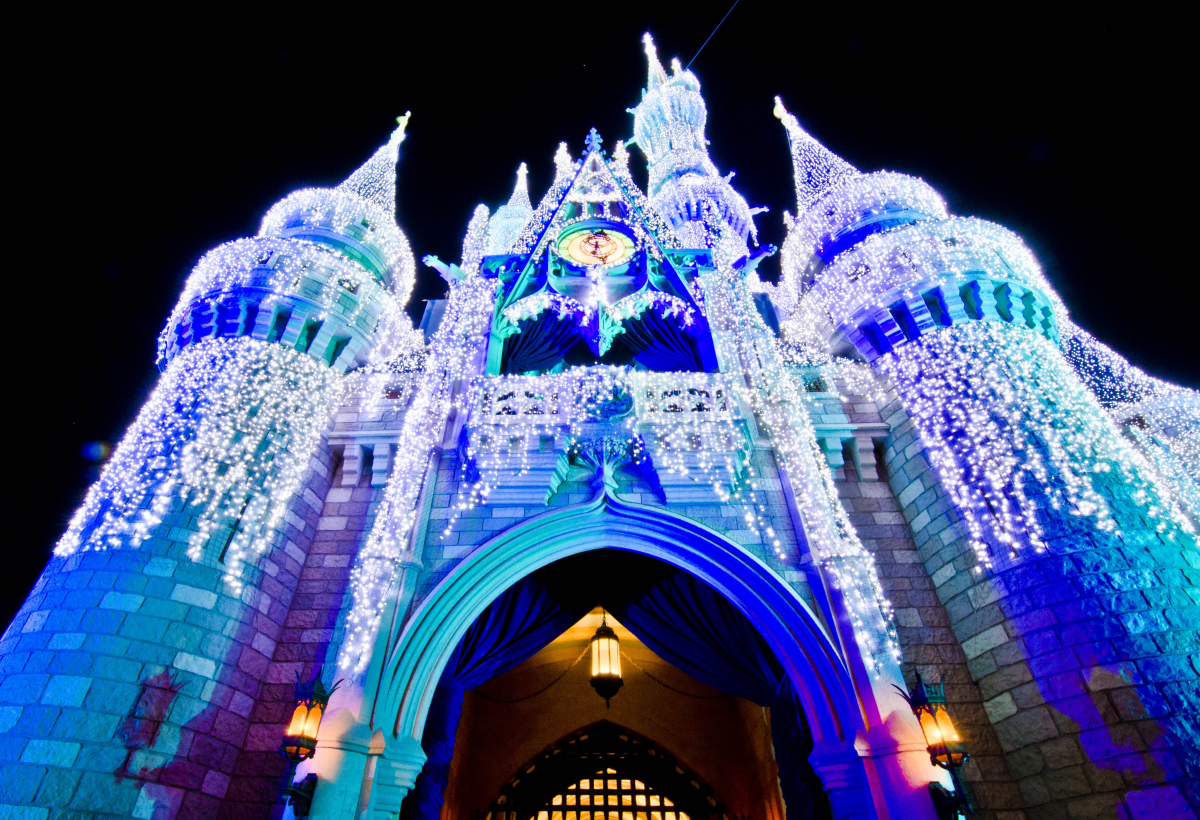 ... castle in the magic kingdom with its thousands of icicle lights