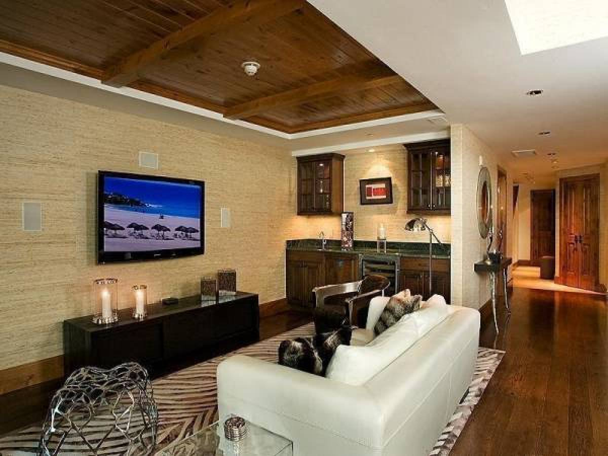 Design inspiration 12 clever tv rooms huffpost for Tv room ideas