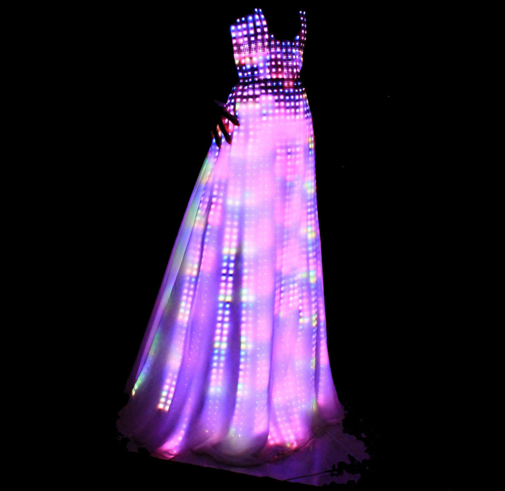 cutecircuit 39 s electric fashion light up dresses have hundreds of led bulbs in fabric photos. Black Bedroom Furniture Sets. Home Design Ideas