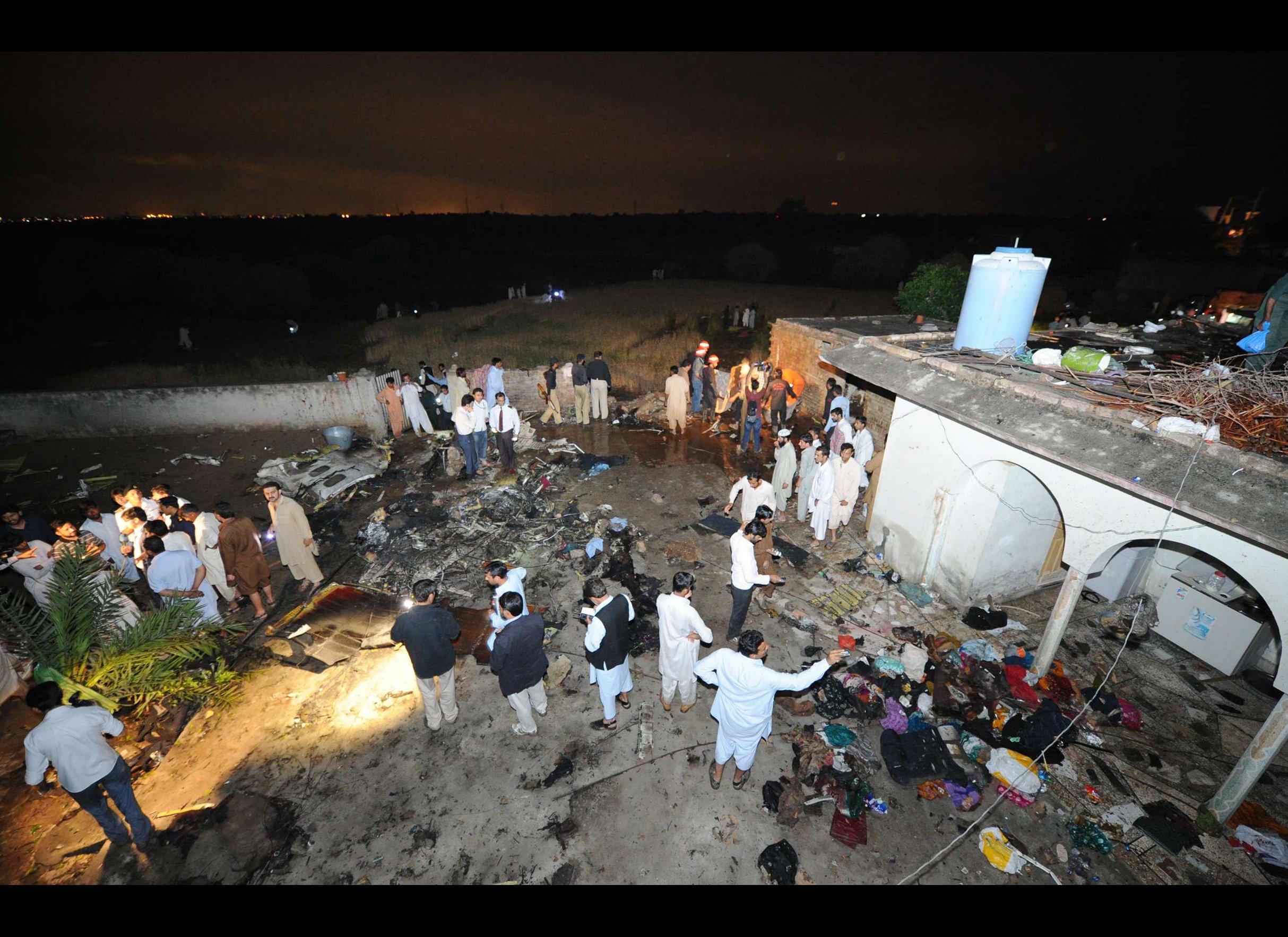 Plane Crash Bodies Photos A plane crash in islamabad