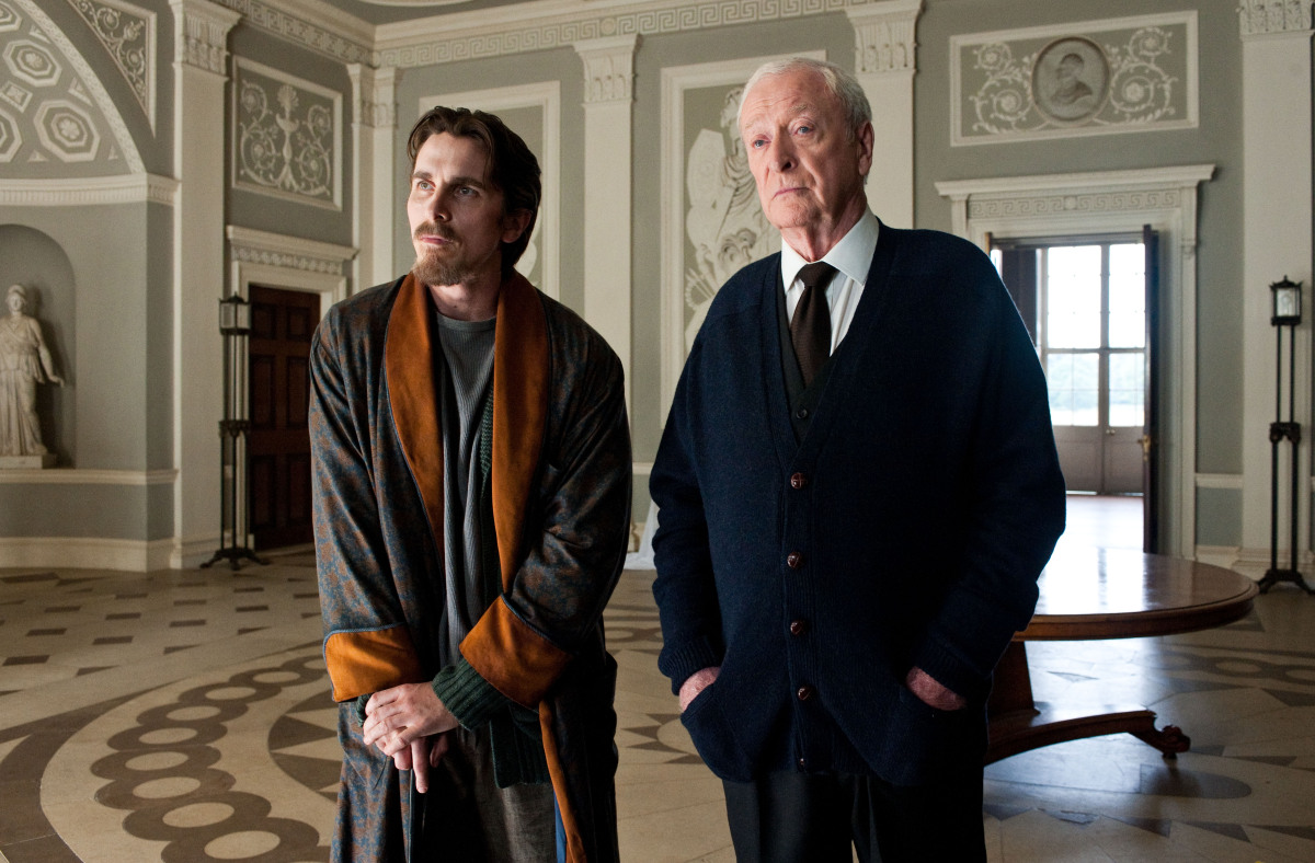 "Christian Bale as Bruce Wayne, left, and Michael Caine as Alfred in a scene from the action thriller ""The Dark Knight Rises."" (Photo credit: AP Photo/Warner Bros. Pictures, Ron Phillips)"