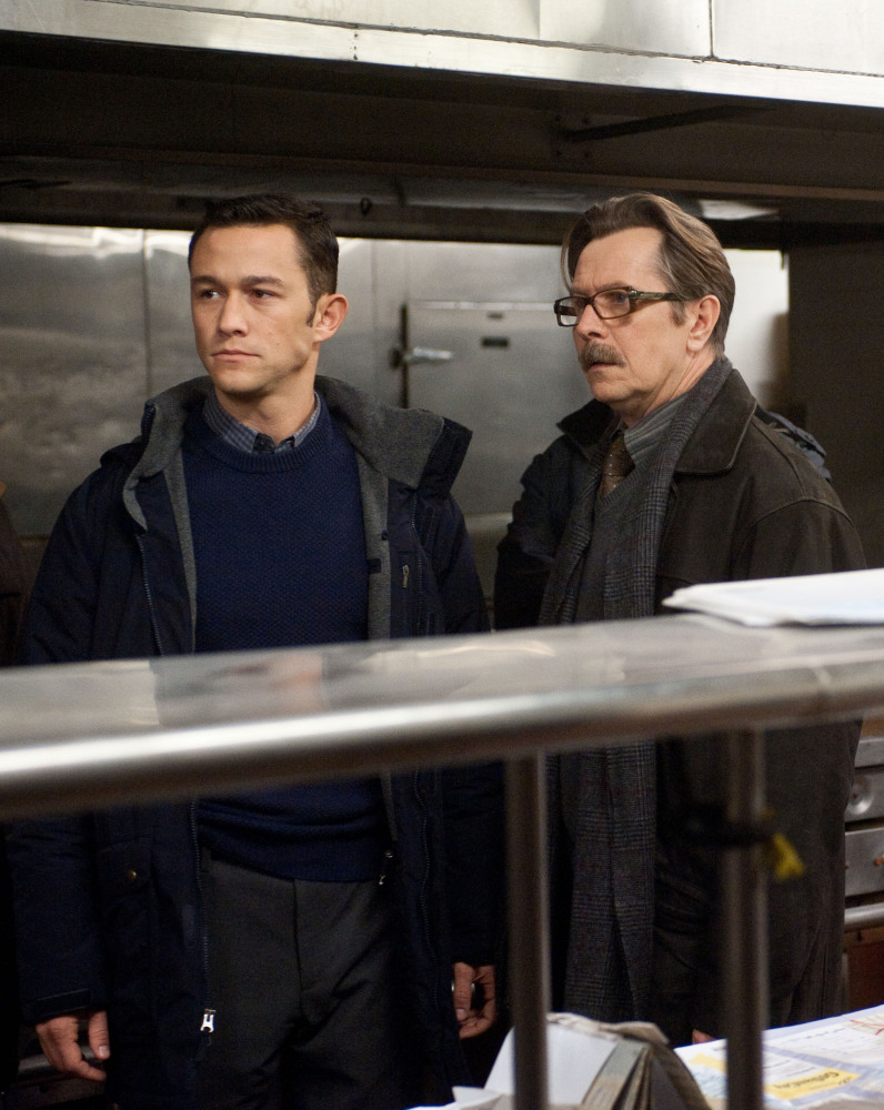 "Joseph Gordon-Levitt as John Blake, left, and Gary Oldman as Commissioner Gordon in a scene from the action thriller ""The Dark Knight Rises."" (Photo credit: AP Photo/Warner Bros. Pictures, Ron Phillips)"