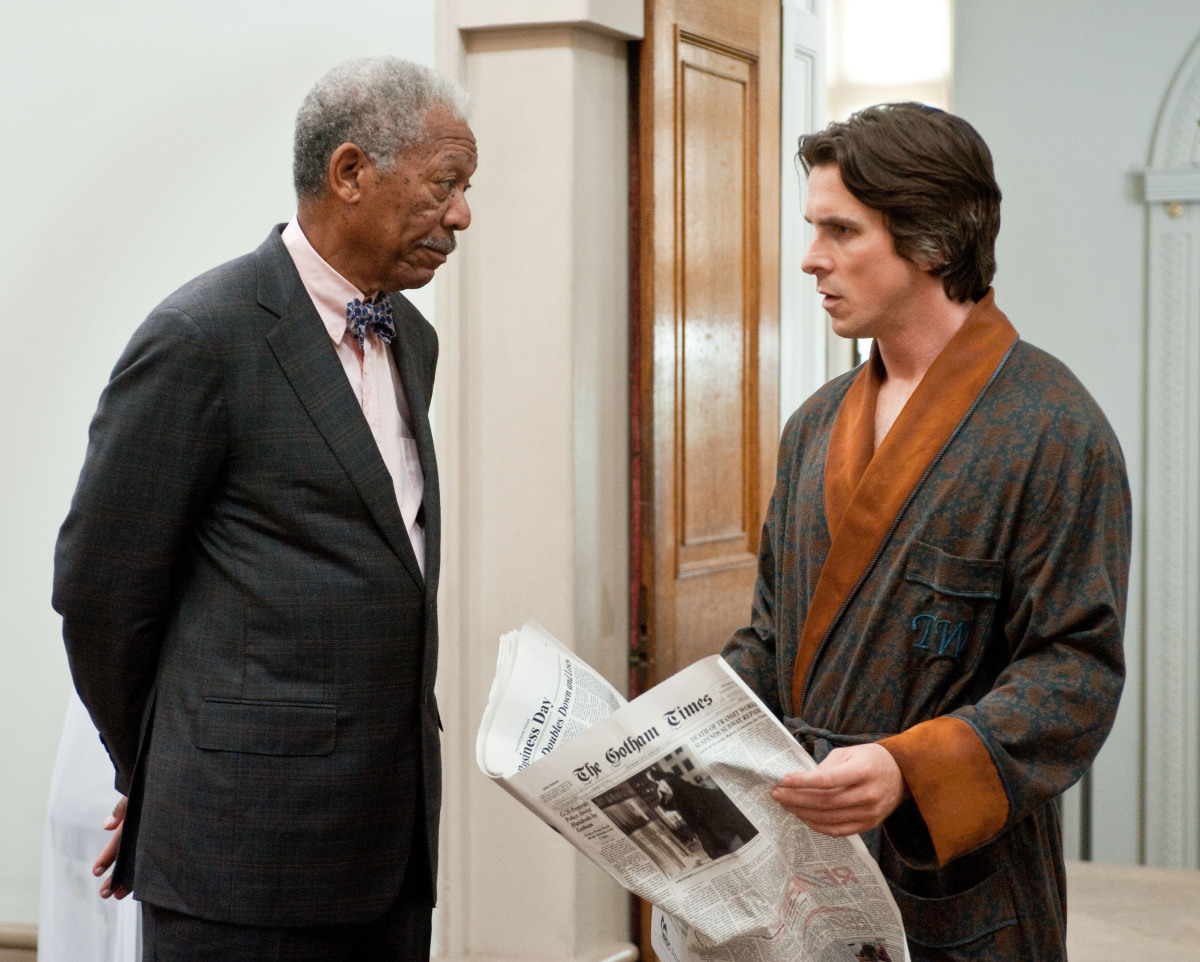 "Morgan Freeman as Lucius Fox, left, and Christian Bale as Bruce Wayne in a scene from the action thriller ""The Dark Knight Rises."" (Photo credit: AP Photo/Warner Bros. Pictures, Ron Phillips)"