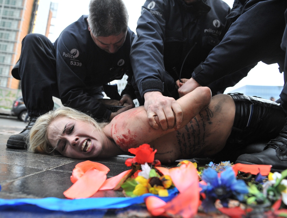 Activists Stage Topless Protest Against Putin