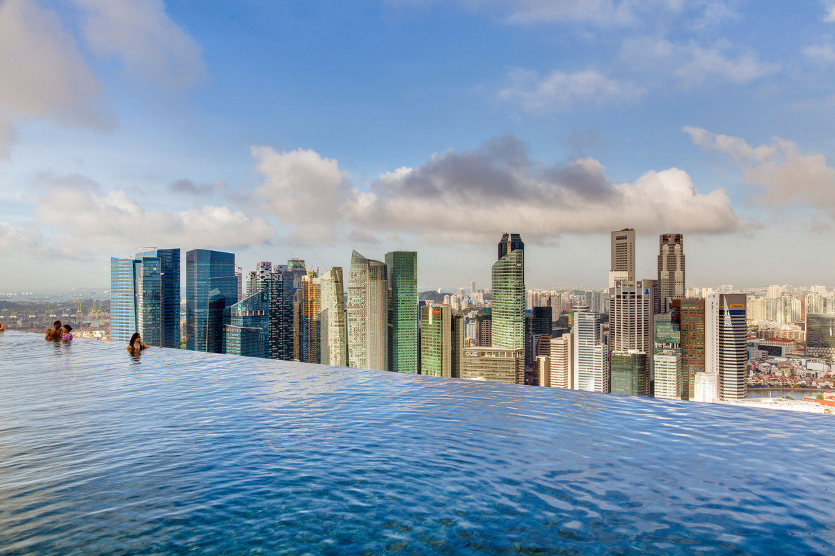 Zaha hadid 39 s one thousand museum tower will have a glass - Rooftop swimming pool in singapore ...