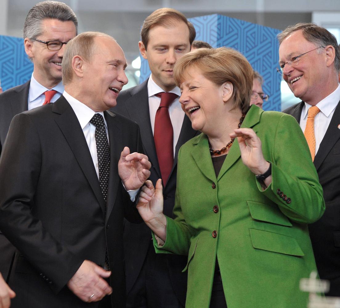 Angela Merkel Topless vladimir putin greetedtopless protester, gives her two