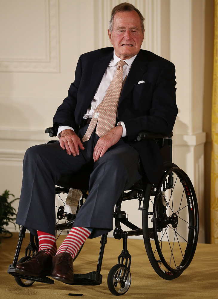 George H W Bush Gives Obama A Pair Of Socks Photo