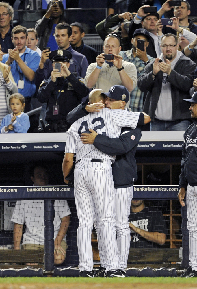 Mo embraces head coach, Girardi, as he makes his way to the dugout