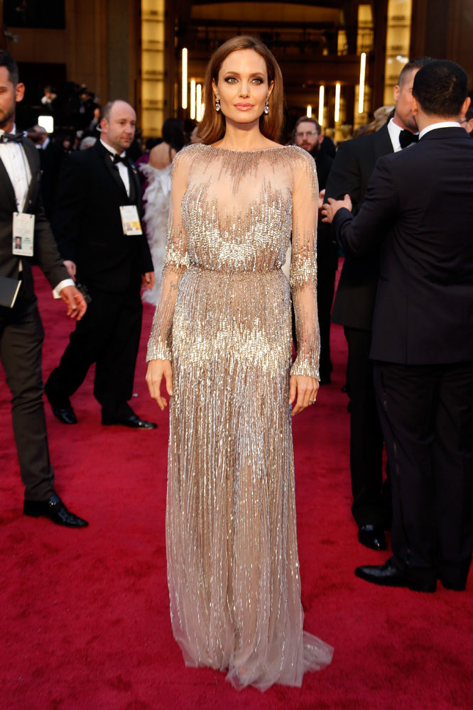 The lady's Oscar looks in sheer, nude colored gown by Ellie Saab