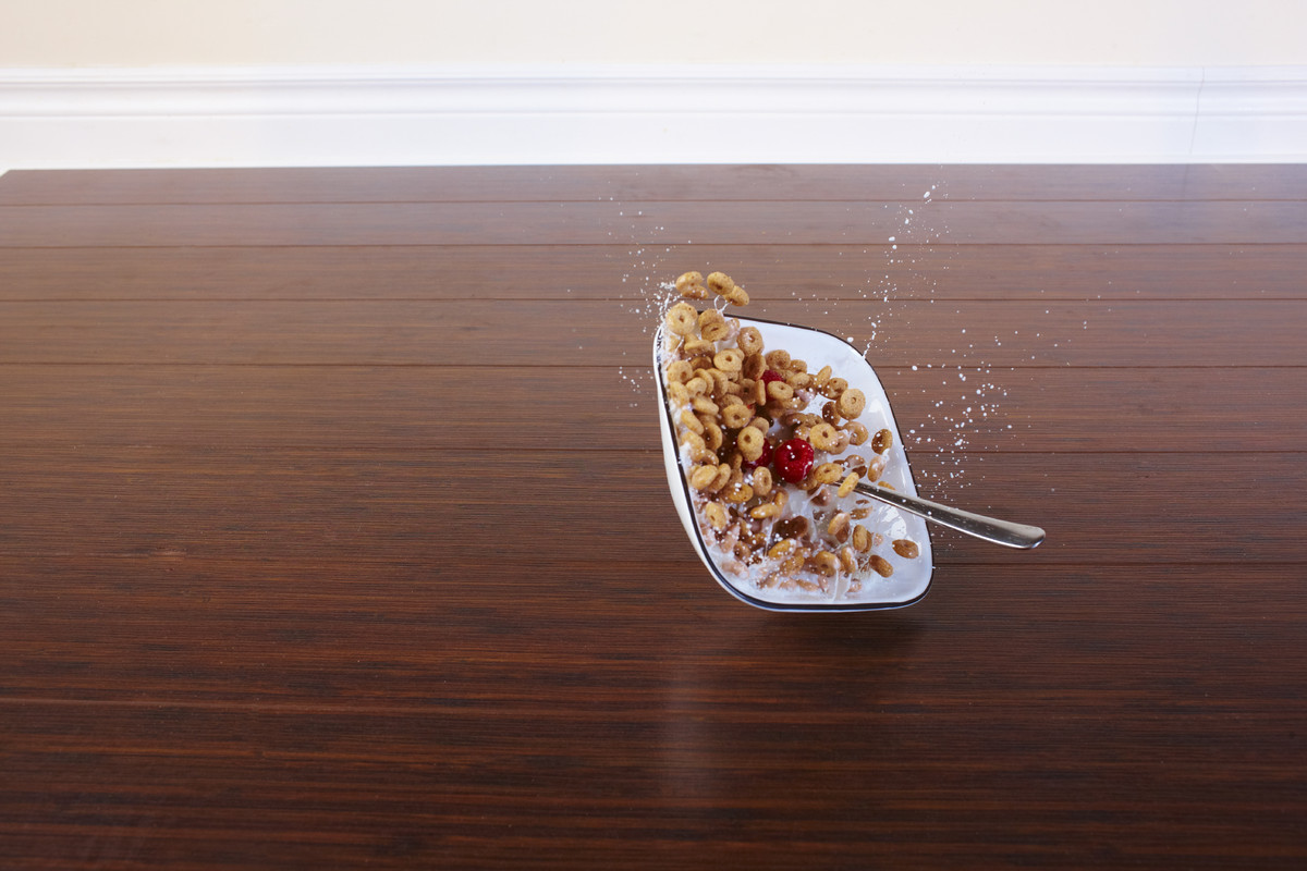 Bowl of cereal falling to the ground