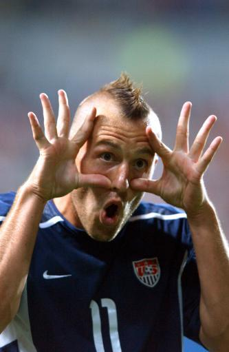 2002 - USA's Clint Mathis demonstrates how Americans tell linesmen to get new specs.