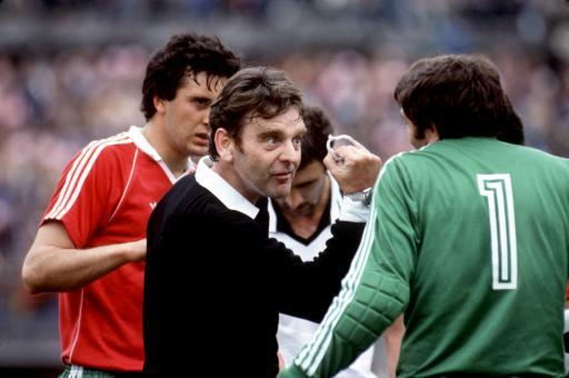 1981 - English football referee Pat Partridge shows goalkeeper Christov who's in charge during Bulgaria's qualifying game against Austria.