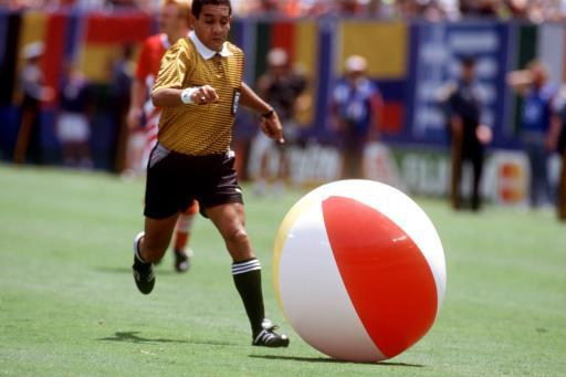 1994-Referee Jose Torres Cadena chases a beach ball during the quarter final between Germany and Bulgaria. If only England could have played with this during its qualifiers...