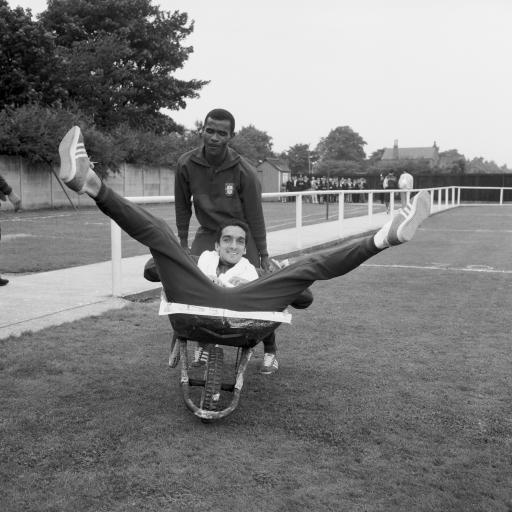 1966 - Portugal's Vicente Lucas pushes teammate Jose Torres around their training ground in a wheelbarrow during a break from training. Ah, life was so much simpler back then!