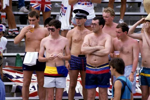 1986 - Dejected England fans - and a policeman - look on as their team lose to Portugal.