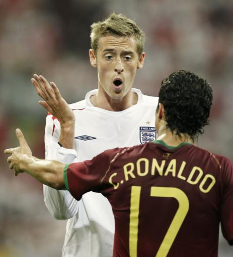 2006 - Crouch takes time off from doing 'the robot' to have a pop at Ronaldo during the quarter-final between England and Portugal.