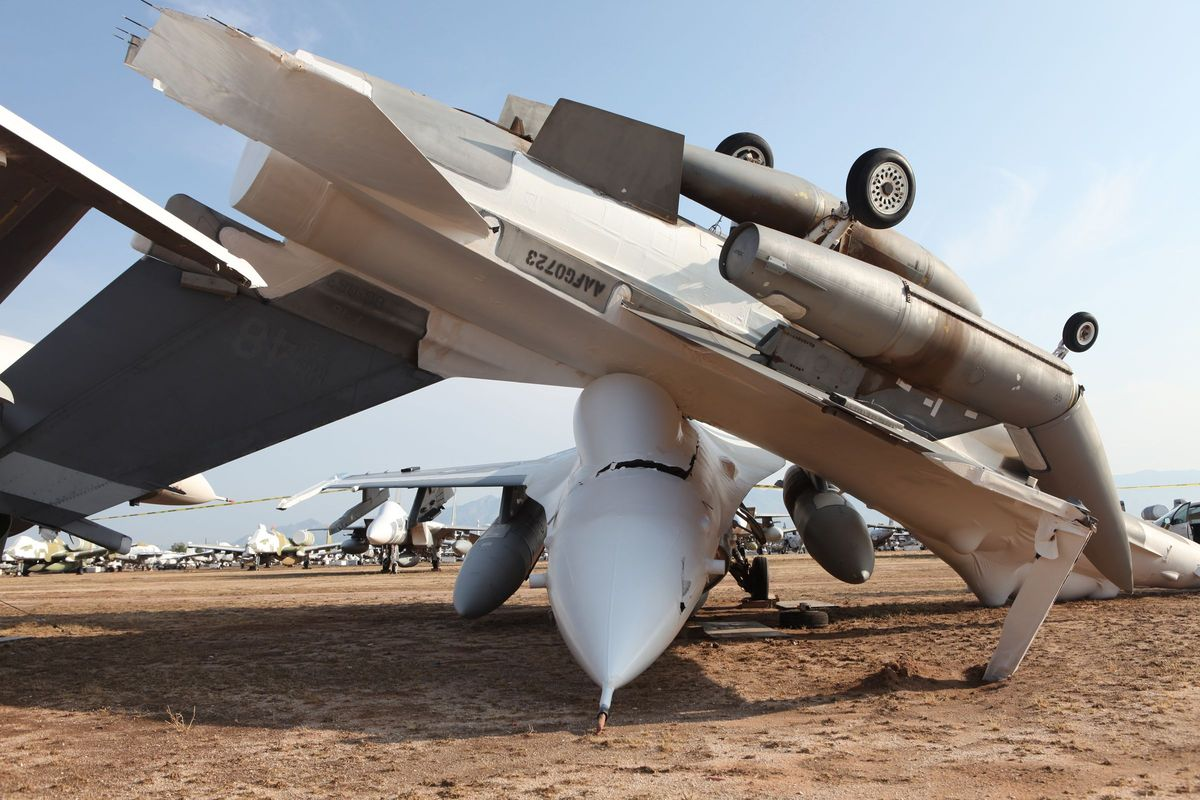 This Image Shows A Lightweight F 16 Fighter Aircraft In Type 1000 Storage Having Undergone An Engine Removal Flipped Onto Another High
