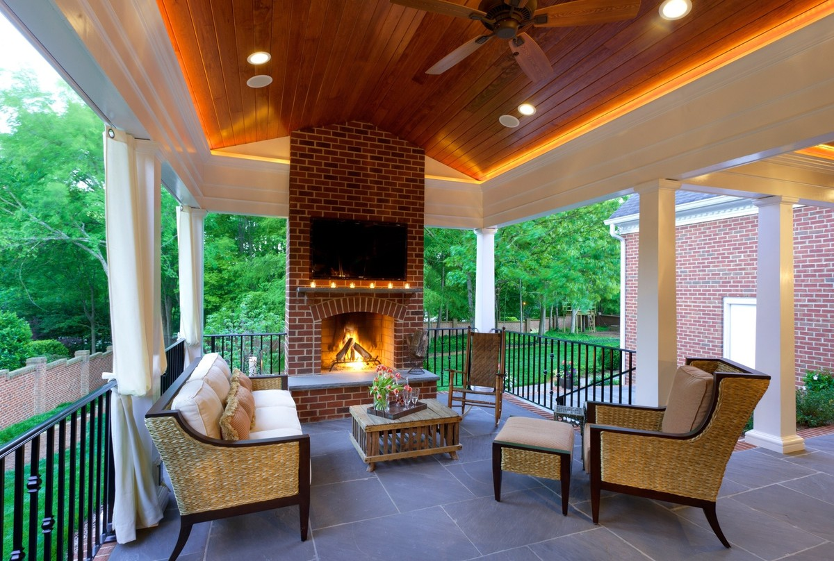 An outdoor fireplace is all you need to keep summer going for Covered porch with fireplace