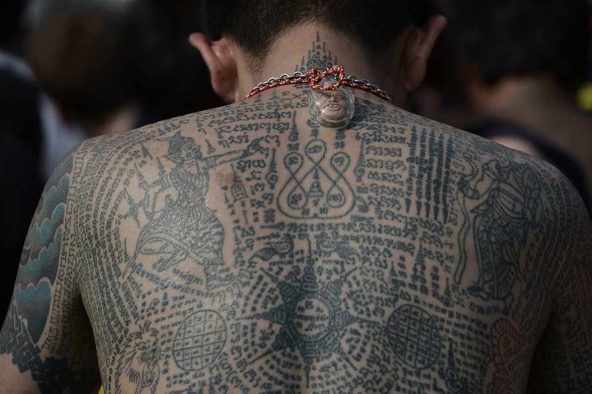 thousands gather in thailand to receive magical tattoos
