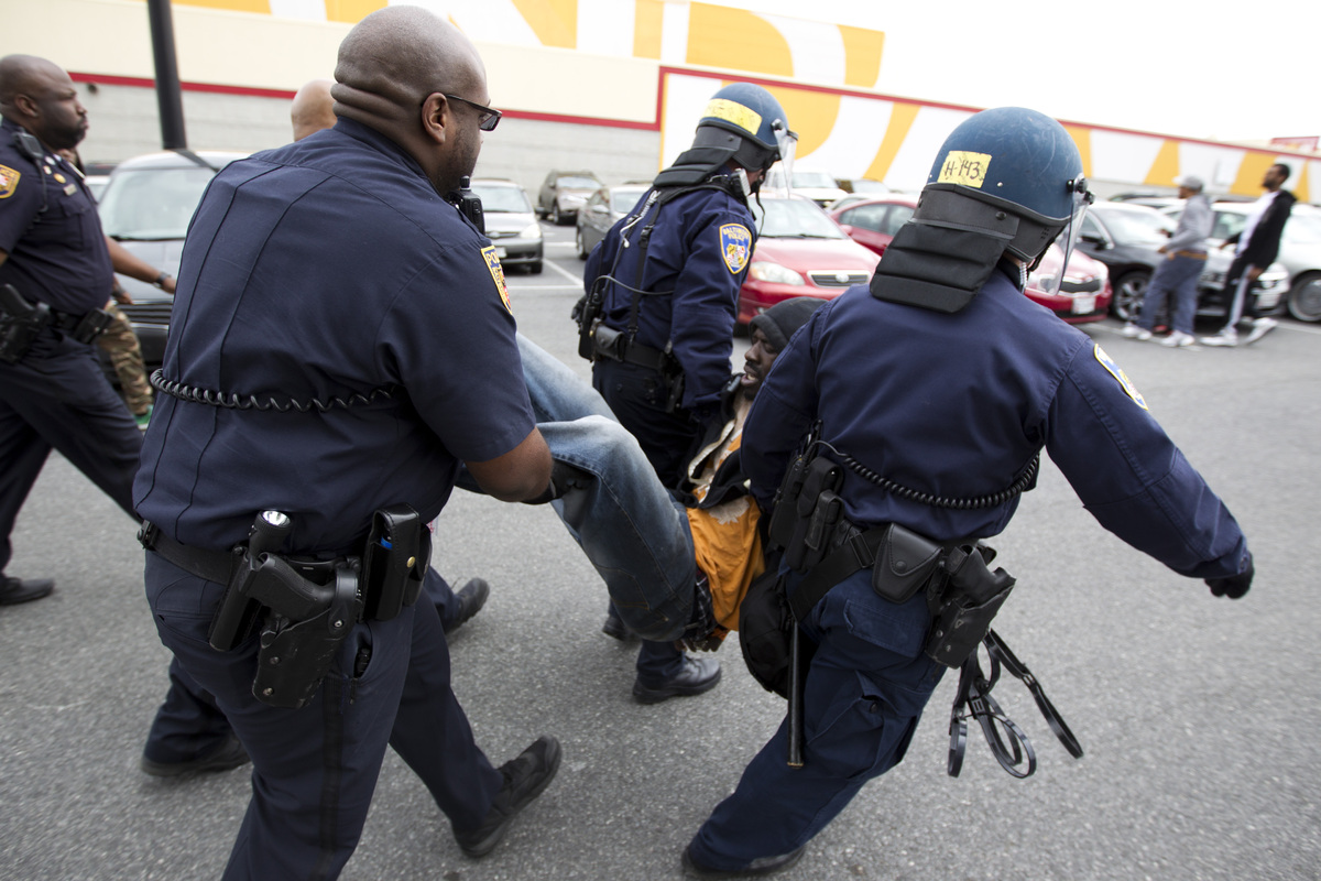 Baltimore police officers in riot gear push protestors back along - How This Inner City Baltimore Principal Is Tearing Down Barriers Between Students And Police Huffpost