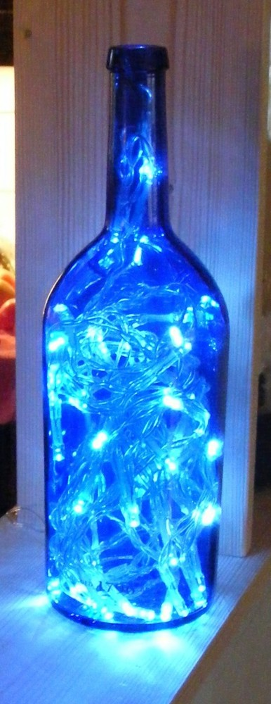 14 creative ways to reuse empty wine bottles huffpost for How to make wine bottle lights