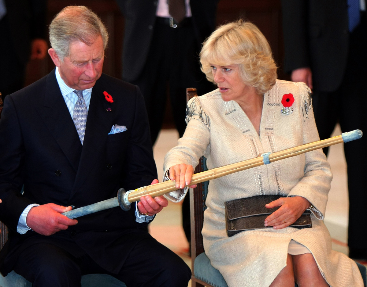 Camilla Duchess Of Cornwall Brandishes Knife During