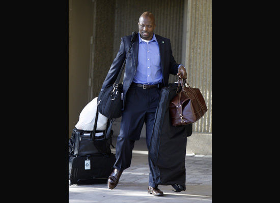 carries Obama 39 s bags to the car in Memphis on September 27 2008