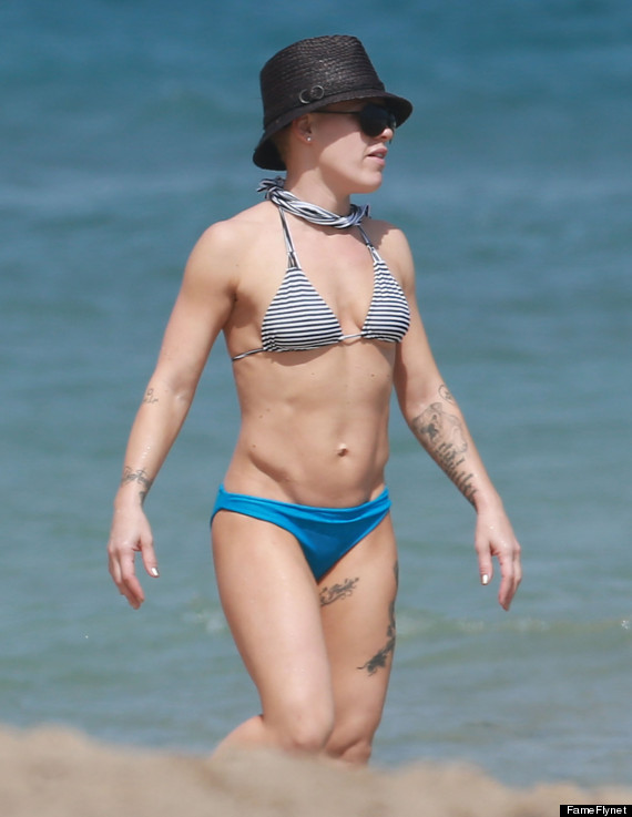 With her athletic body and Regular blond hairtype without bra (cup size 32B) on the beach in bikini