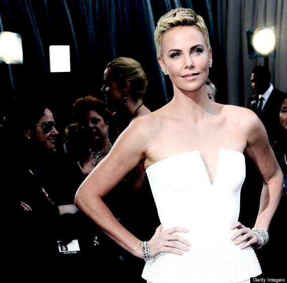 charlize theron helps guard