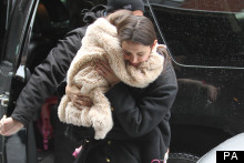 Heavy Lifting: Katie Holmes Carries Six-Year-Old Suri In New York