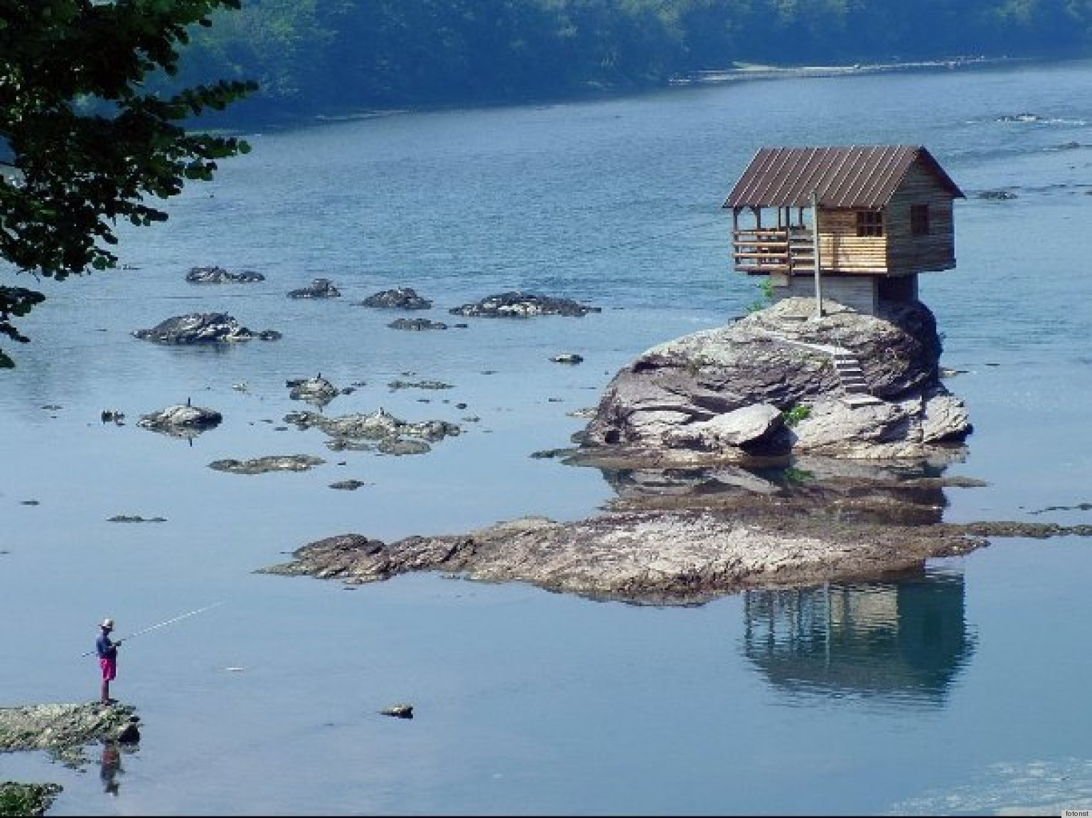 Tiny Home On Drina River In Serbia Sits On Rock Surrounded