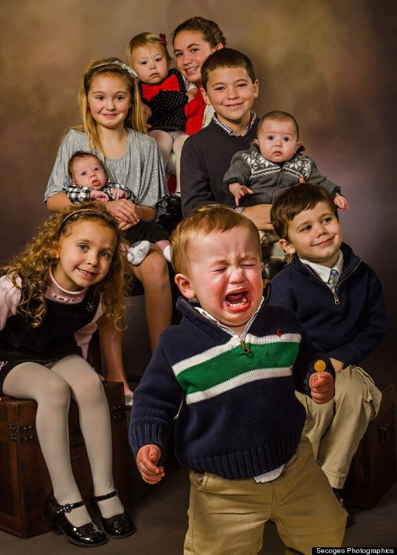 Kids do the darnest things: Toddler turns picture into the 'greatest family photo' ever (LOOK)