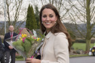 Kate Middleton Hides Baby Bump In White...