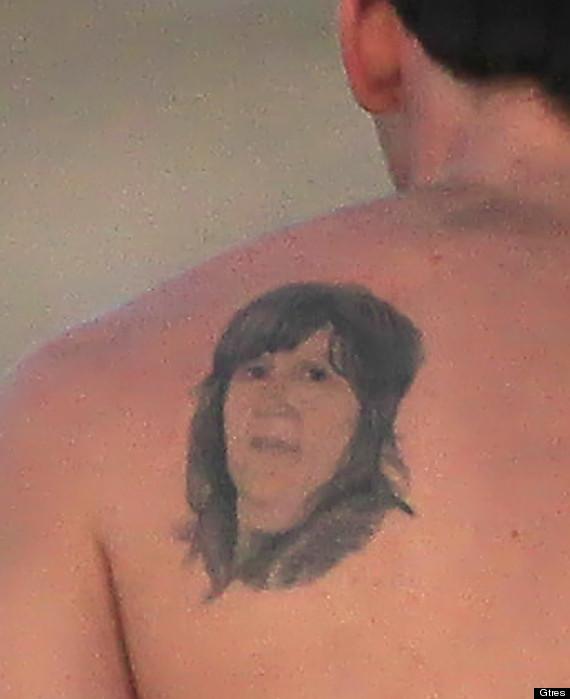 messi tatuaje espalda