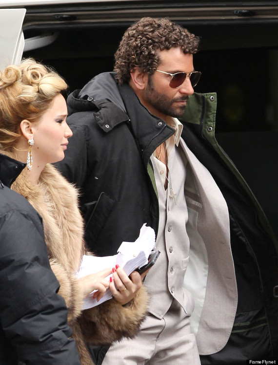 Bradley Cooper's curly hair after a perm with pink rods for a new David Russell movie
