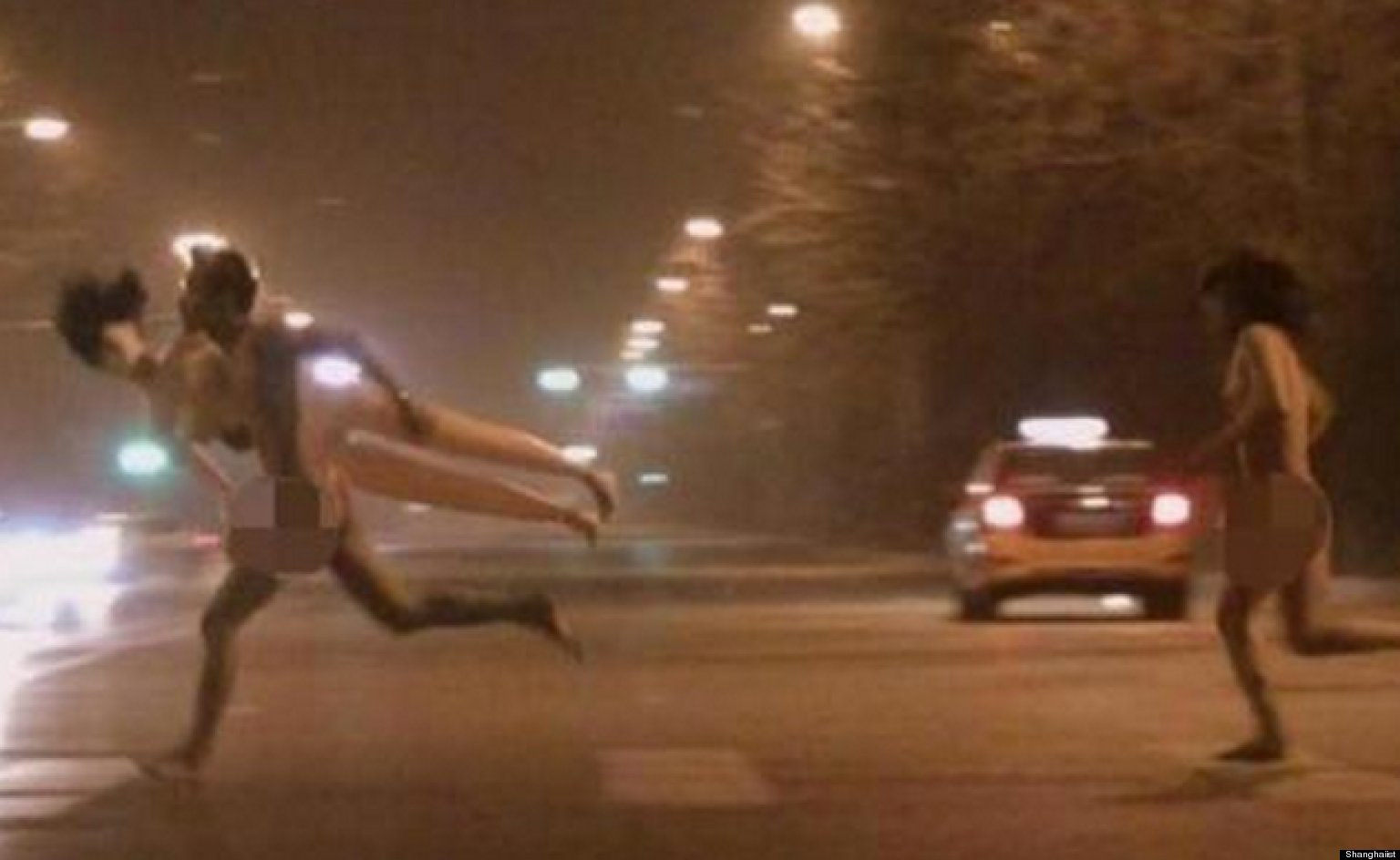 Naked Woman Chases Naked Man Carrying A Sex Doll Through Beijing