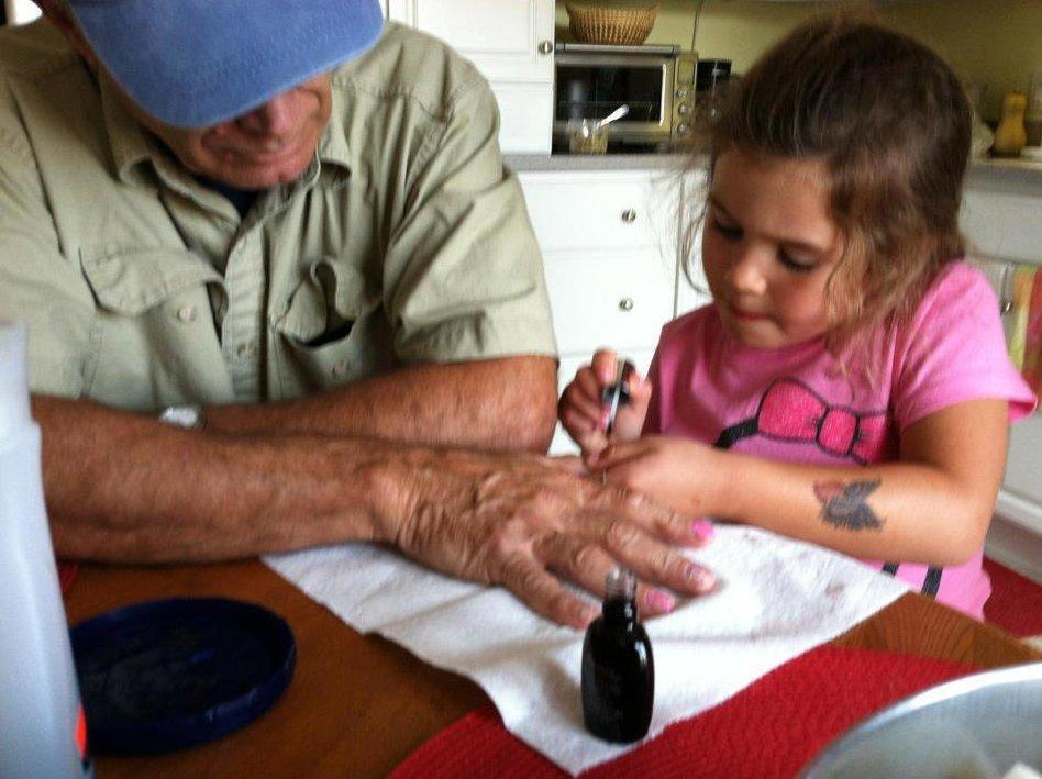 giving grandpa a manicure