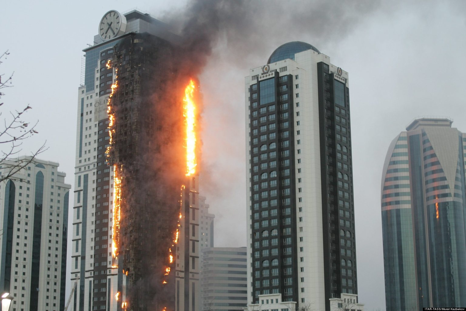 http://i.huffpost.com/gen/1070238/images/o-OLYMPUS-TOWER-FIRE-CHECHNYA-facebook.jpg