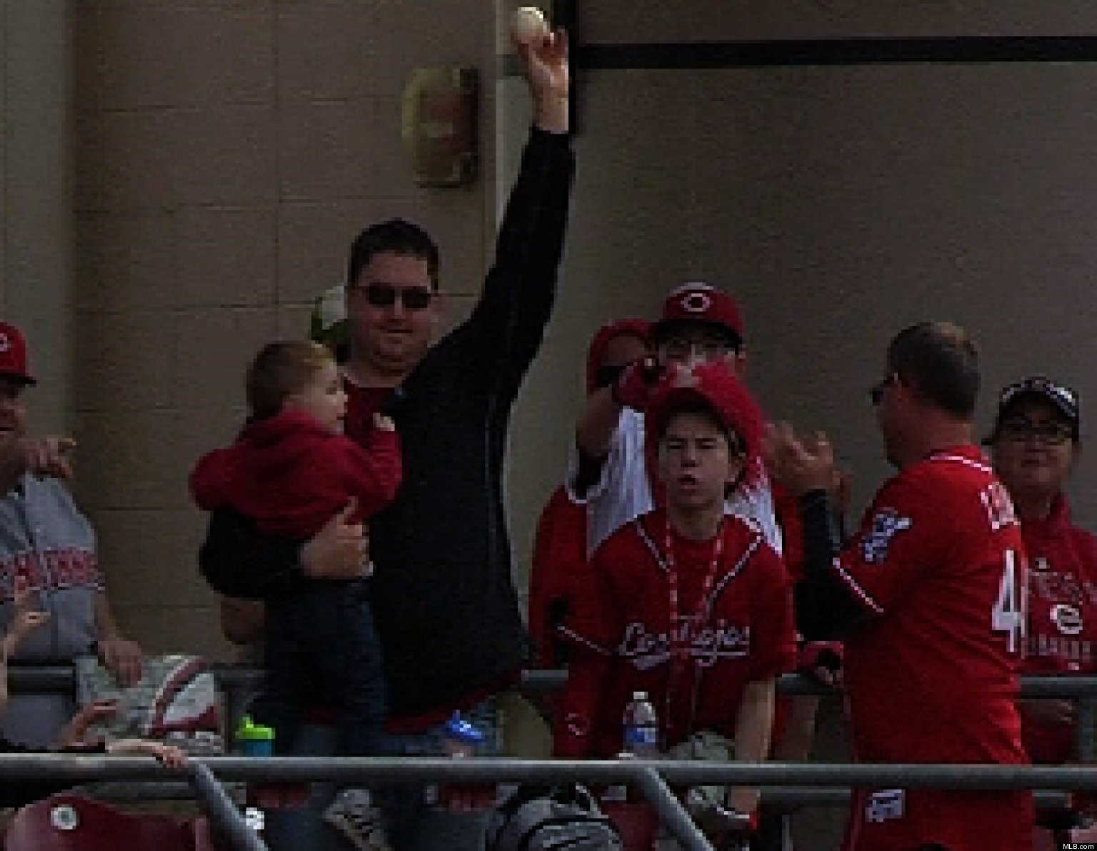 WATCH: Dad Catches Foul Ball While Holding Baby
