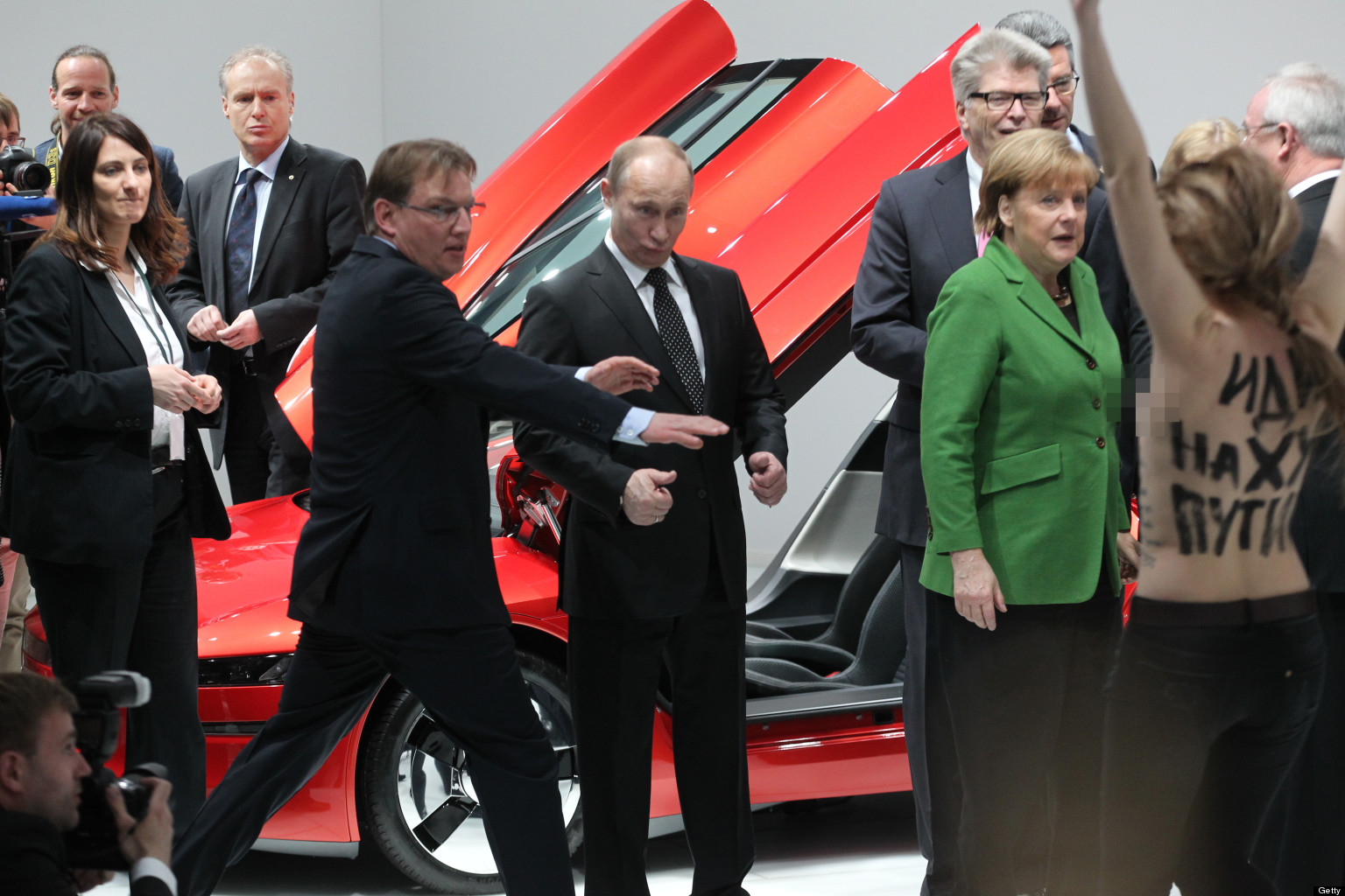 Putin Topless Protest: Russian President's Germany Visit ...