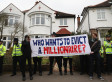 'Bedroom Tax' Protests: UK Uncut Hand Eviction Notices At Homes Of Iain Duncan Smith And Tory Peer Lord Freud (PICTURES)