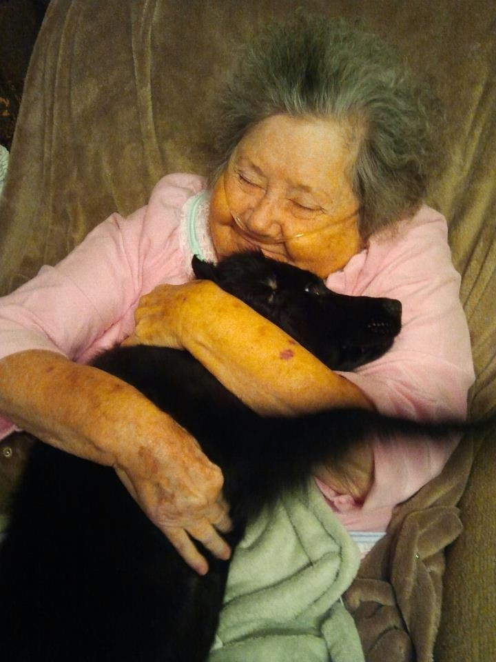 photo of granny hugging dog
