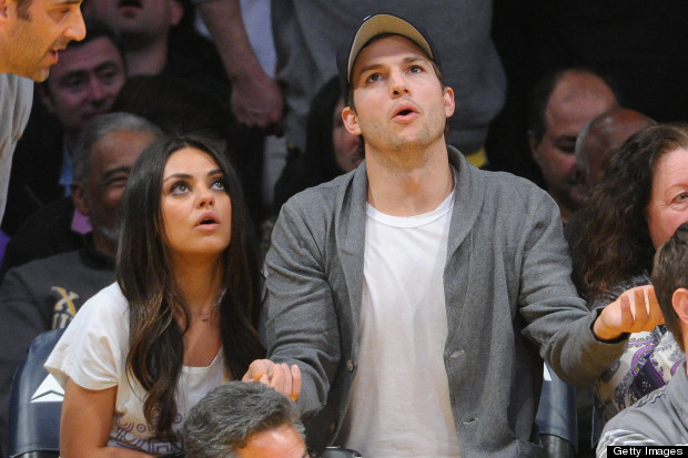 mila kunis ashton kutcher boating holiday in norfo