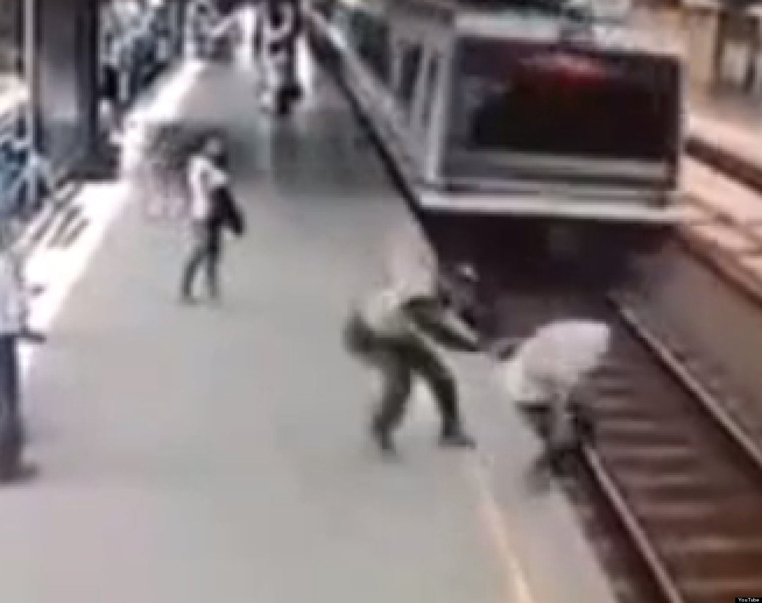 WATCH: Cop Saves Man From Train