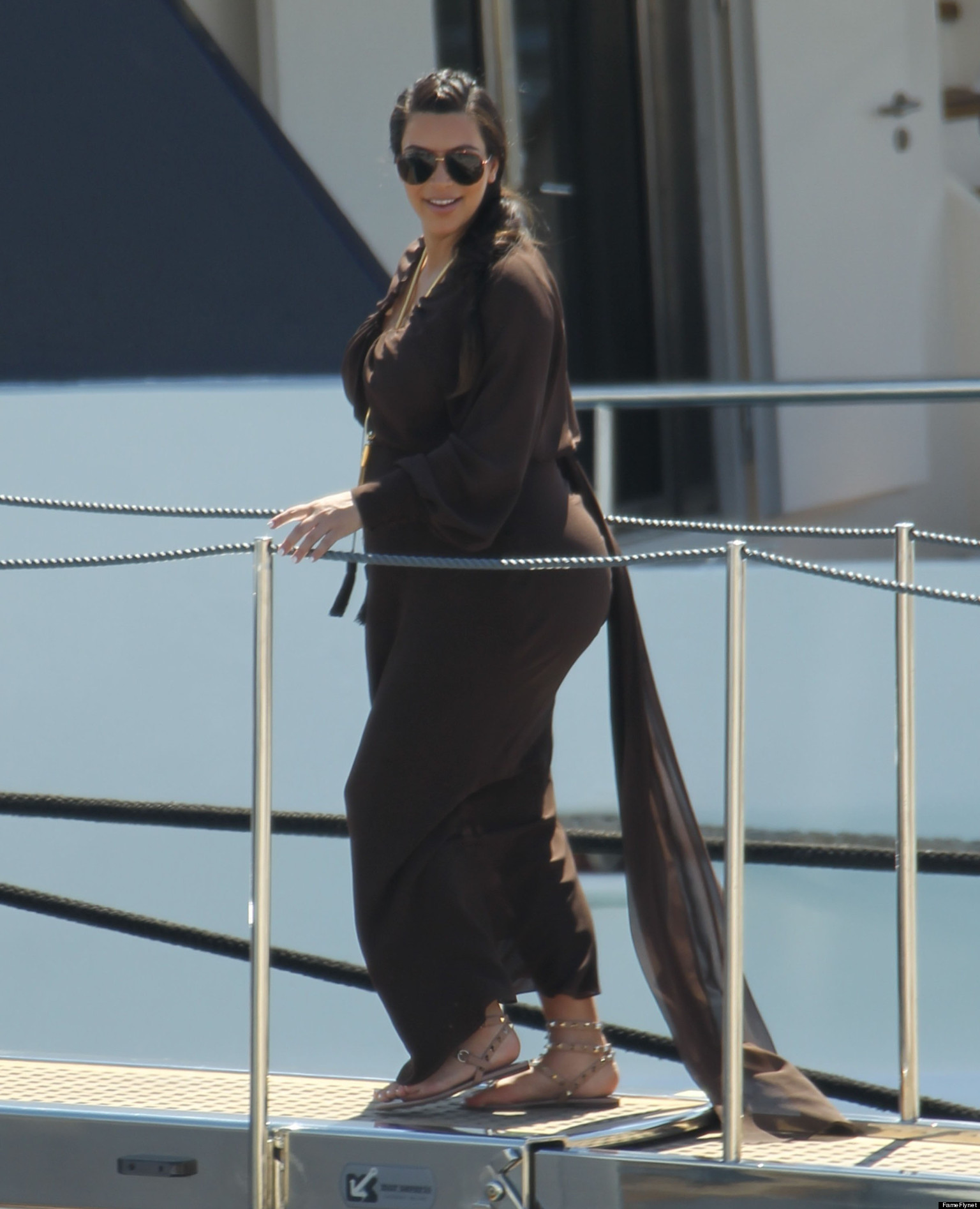 Kim Kardashian Flaunts Pregnancy Curves In Greece