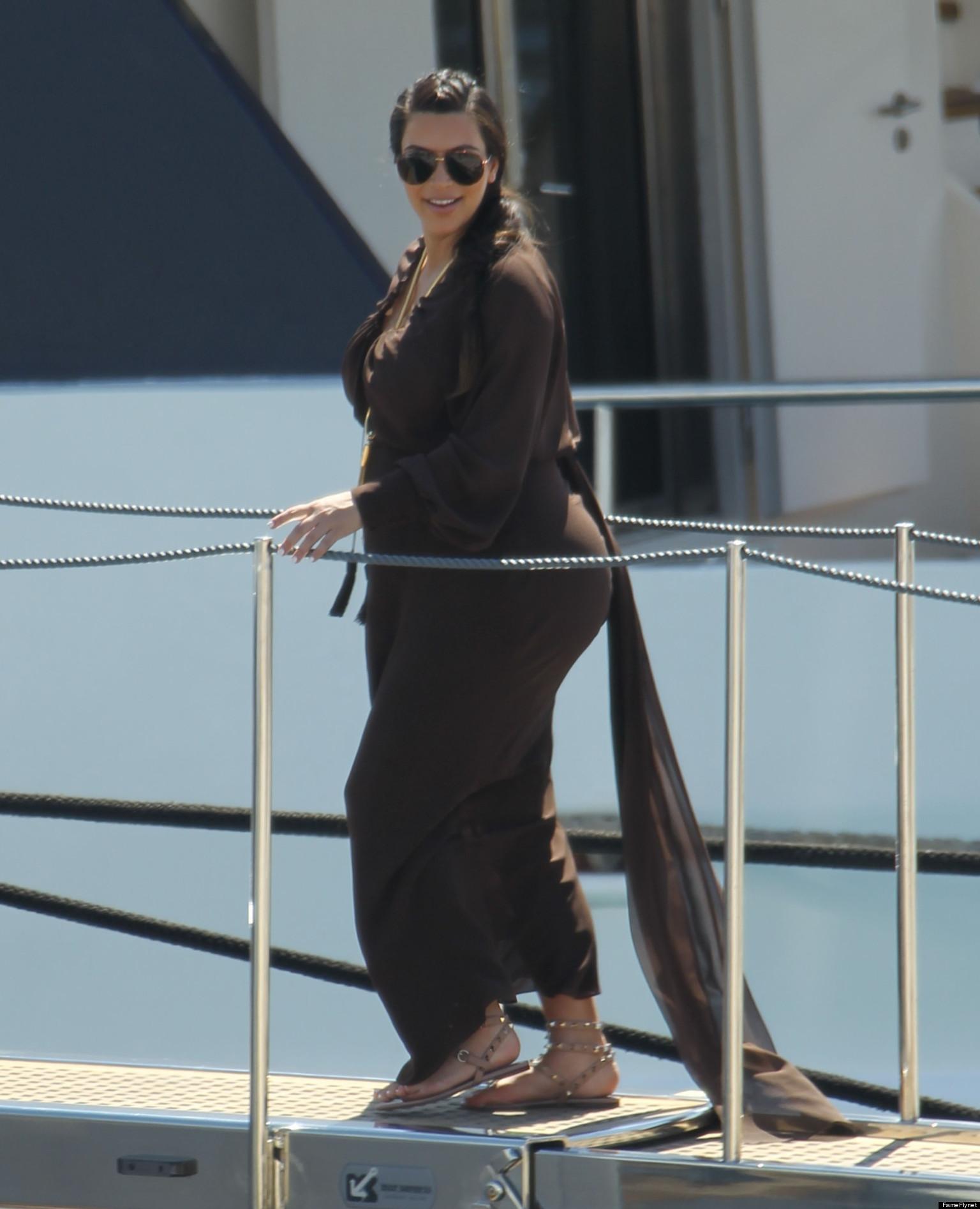 Kim Kardashian Flaunts Pregnancy Curves In Greece