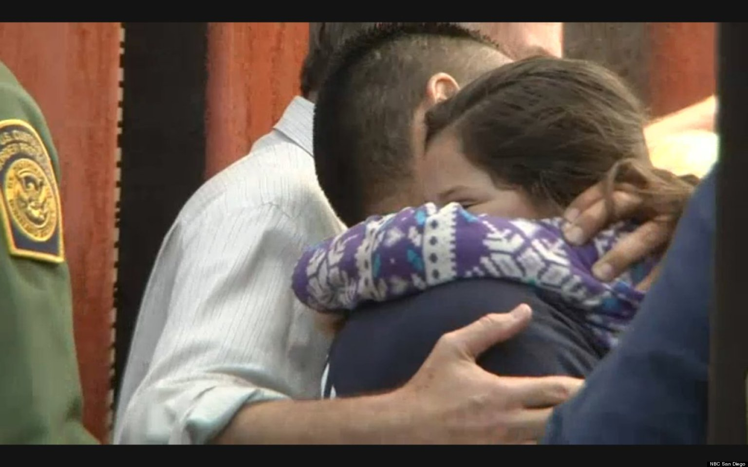 WATCH: Immigrant Dad Hugs Daughter For First Time In Emotional Border Scene
