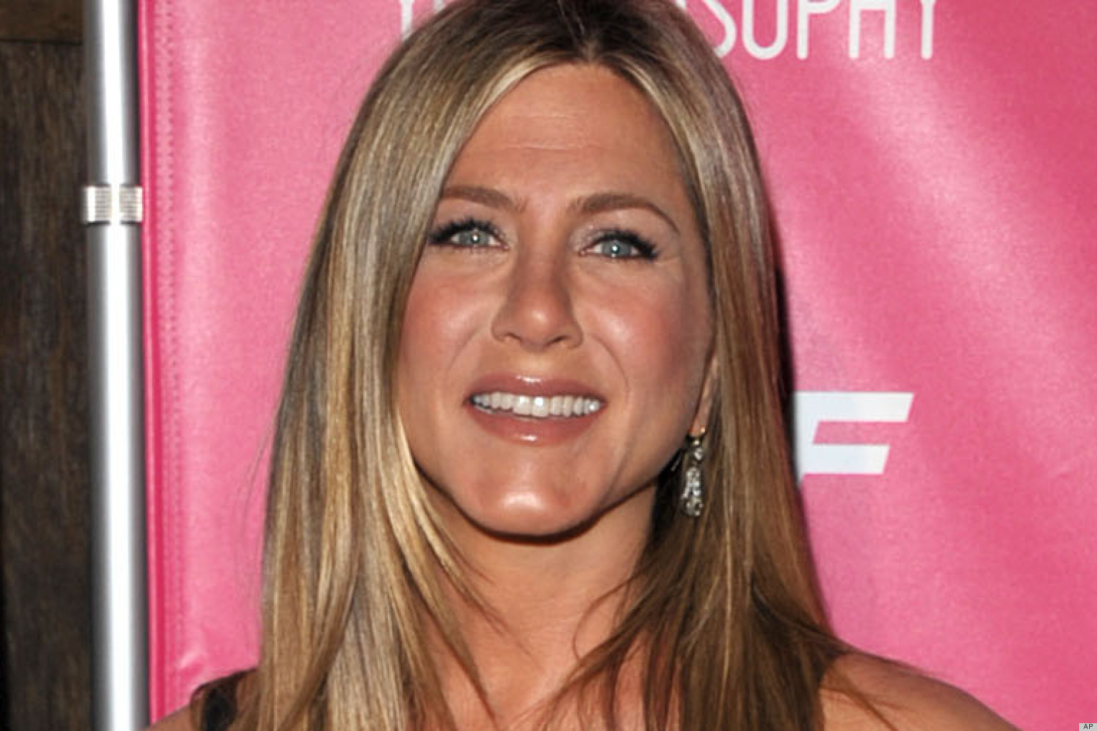 PHOTOS: Jennifer Aniston Takes The Plunge In An LBD