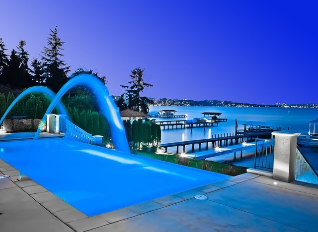 10 gorgeous swimming pools that will immediately make you for Fancy swimming pool designs