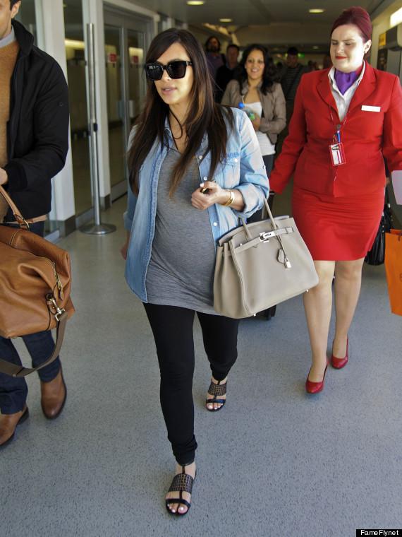 Mummy dearest: Kim Kardashian keeps it super cool in clingy dress (LOOK)
